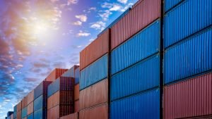 What happens when a container needs to be changed in a transshipment port?